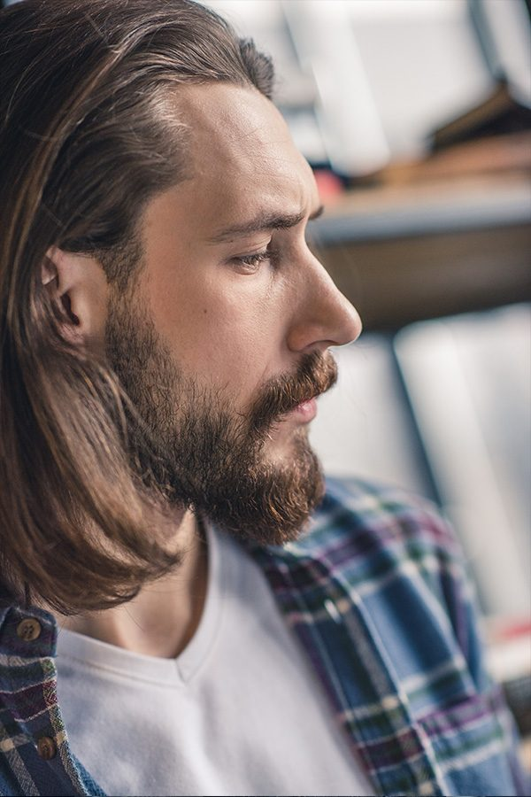close-up-portrait-of-young-pensive-bearded-man-RJCGFCZ.jpg